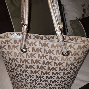 MK  Tan bag with brown logo. Medium size. Like new